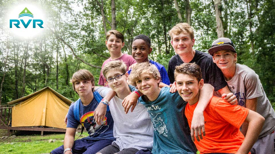 boys outside summer camp tent